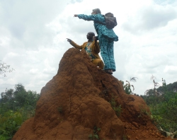 Seen here Rev Abraham and Jenny up a ant hill on Hope Estate!