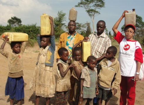 Children walk for miles to the Land Sand Mining borehole