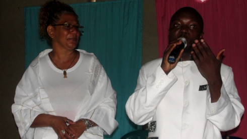 Rev Abraham Kisembo and Lisa on the mountain