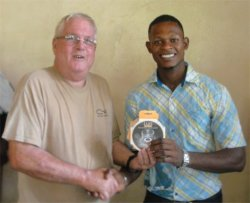 Phil Edwards from the Living Room distributing the Luci Solar Lights dontated 