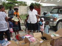 Dr. Yolander Thervil better known as Mama Yol joined Jenny Tryhane, Founder and Chairman of United Caribbean Trust in the distribution to the darling children at this small orphanage not far from the YTF Orphanage in Bon Repose.