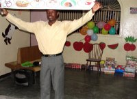 Seen here Pastor Banes the Kids' EE Haiti Director demonstrating the 'Gospel in a nutshell'.