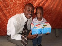 Daniel Noel distributed Make Jesus Smile shoeboxes at the Nazarene church in Goniave on Sunday morning.