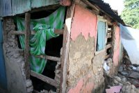 The rich and the poor were impacted alike, seen here a mud hut
