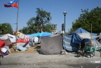 Most people in Port au Prince continue to sleep under tents, tarps or sheets.