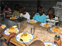 HaitiOne partnering with United Caribbean Trust feeding children in Haiti physically and Spiritually