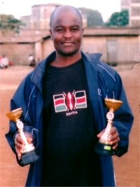 Seen here Rev Kennedy Salano in his Kenyan football shirt holding the trophies.