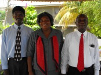 Seen here Pastor Williams and his wife with Pastor Banes the Kids' EE Haiti coordinator outside the church. .