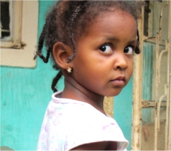 This little girl lives in the Orphanage in Uganda that United Caribbean Trust (UCT) is attempting to purchase.