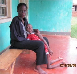 Joy and Ethel who live at the orphanage located next door for sexually abused street children in Uganda.