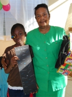 Orphan in the Bon Repos orphanage receiving their Make Jesus Smile shoeboxes