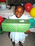 Special thanks to the children of Power in the Blood Assemble who wrapped and packed these beautiful Make Jesus Smile shoeboxes for this child