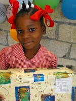Seen here an orphan at the Maranatha Ministries Orphanage receiving her Christmas 2008 Make Jesus Smile shoebox thanks to Power in the Blood Sunday School class in Barbados.