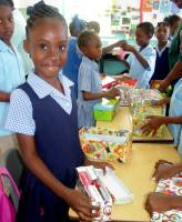 Half Moon Primary School children packing  shoe boxes for the children in Haiti
