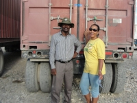 Pastor Banes with Lady Mary Beckles from Holy Seed International outside of the container.