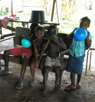 The children enjoying the balloons donated by Laurie Dash the Toy Shop in Barbados