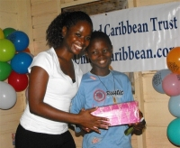 Kathy Ann Sanderford from New Dimensions Ministry in Barbados seen here distributing the Make Jesus Smile shoeboxes.