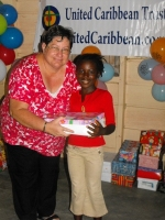 Kim Smith from Restoration Ministries in Barbados distributing the Make Jesus Smile shoeboxes to the Maroons in Tjaikondre.