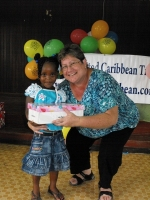 Kim Smith from Restoration Ministries in Barbados distributing the Make Jesus Smile shoeboxes to the Maroons in Victoria.