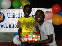 Imran Richards representing the Wesleyan Holiness church in Barbados seen here distributing the Make Jesus Smile shoeboxes.