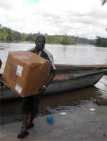 Seen here the Make Jesus Smile shoeboxes being transported up the Suriname River and arriving at Tjaikondre.