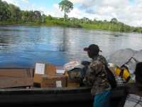 Seen here the shoeboxes arriving at Tjaikondre having travelled up the Suriname River.