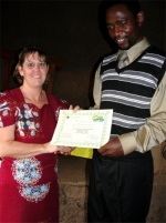 Seen here receiving his KIMI certificate from Pastor Laura in Uganda.