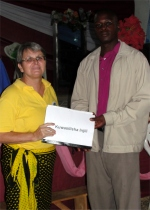 Gwalughano Mwalusamba was trained in KIMI in Mbeya, seen here receiving his Child Evangelism curriculum from Jenny