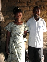 Pastor David with one of the graduates in her home