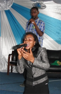 Seen here with Pastor David behind her leading worship