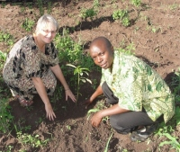 Seen here Jenny Tryhane, Founder of UCT  with Pastor Abraham, the Uganda UCT Representative planting a memorial Avocada tree on the boundary of the land.