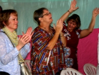 Seen here with the KIMI team Pastor Laura and Liz in worship during their first week in Africa.